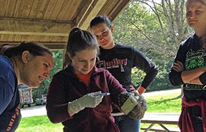 [students examine turtle]