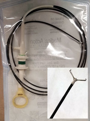 [endoscopy tube and inset closeup of grabber]