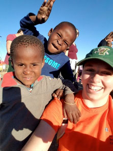 [Rachel Stuart in South Africa with local kids]