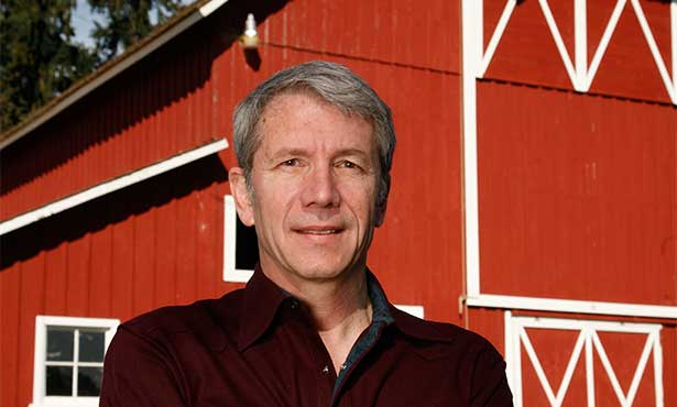 [Rep. Kurt Schrader standing in front of a barn]