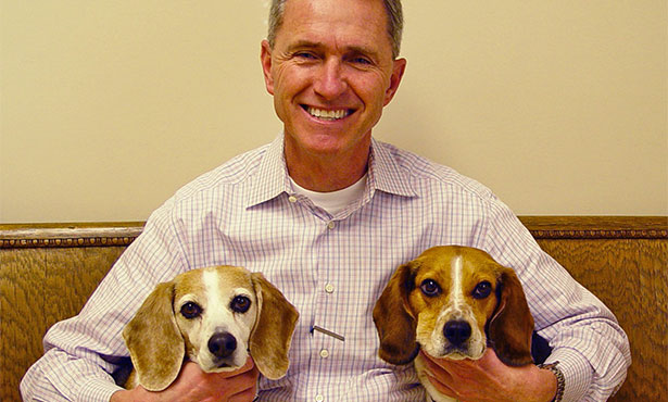 [Dr. Tim Sullivan and his two beagles]