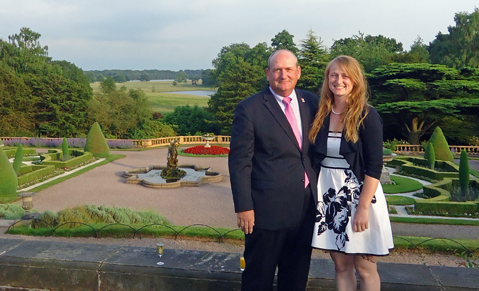 [Dr. Jonathan Foreman and Catherine Foreman in formal English garden]