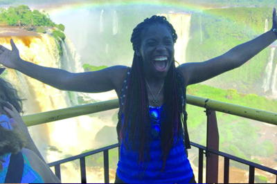 [Taylor Jones poses in front of a waterfall while studying abroad in Brazil]
