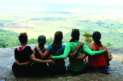 [Tanzania study abroad group poses together on a cliff]