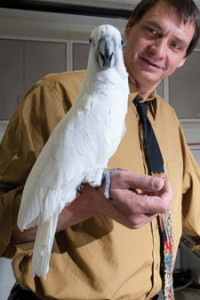 [Dr. Kenneth Welle with a bird]