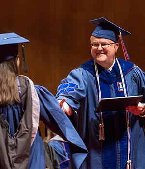 [Dean Constable congratulates graduate]