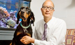 [Dr. Tim Fan with his dog]