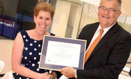 Jodi Flaws receives all-around excellence award from Dean Peter Constable