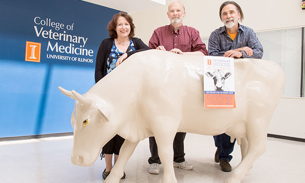 [Sinn-Hanlon, Craig, and Helms with poster trigger for 3-D cow app]