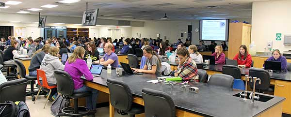 students hear lectures in a microbiology lab