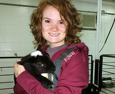 [Allison Bergin with lamb]