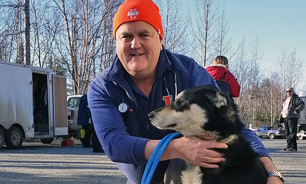 [Illinois veterinary college dean Peter Constable and a sled dog in Alaska]