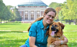 [Robin Holland and her dog on the UI quad]