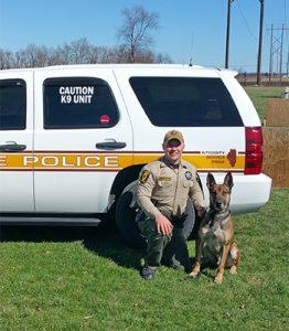 [working dog Arko and Officer Van Hoveln]