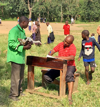 [children at an outdoor clinic]