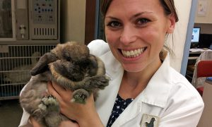 [Dr. Krista Keller poses with a pet rabbit]