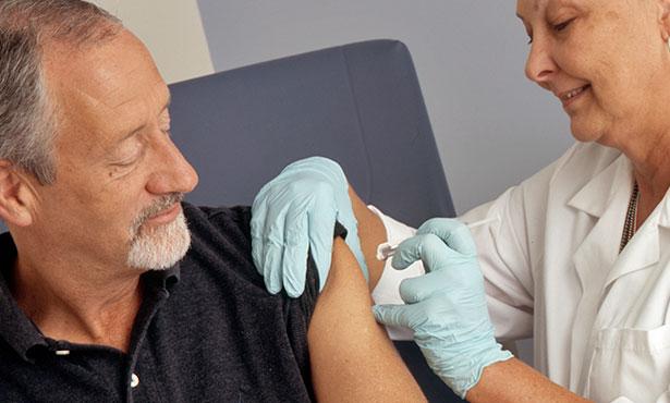 [a nurse vaccinates a person]