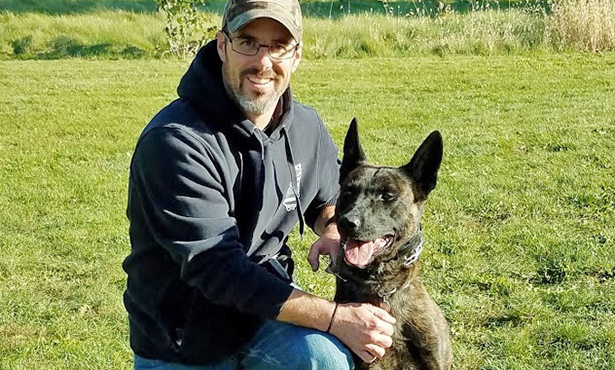 [Deputy Chad Beasley and his partner Arco]