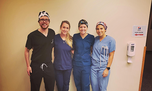 Students pose after third-year surgery