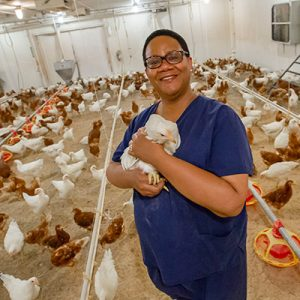 [Dr. Yvette Johnson-Walker in a hen house]