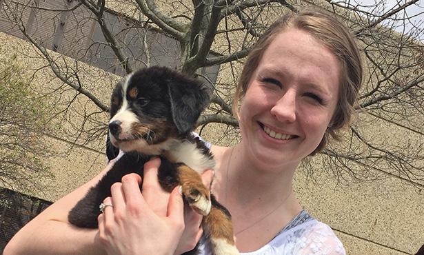 [Dr. Brittany Kleszynski holding a puppy]