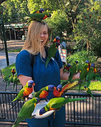 [Kara Hiebert and parrots]
