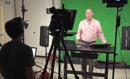 [Dr. Jim Lowe presents a webinar in front of a green screen]