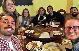 [enjoying local cuisine with Brazilian friends]