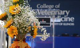 [floral arrangement near college name]