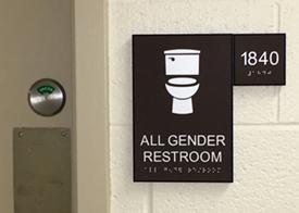 [sign outside all-gender restroom]