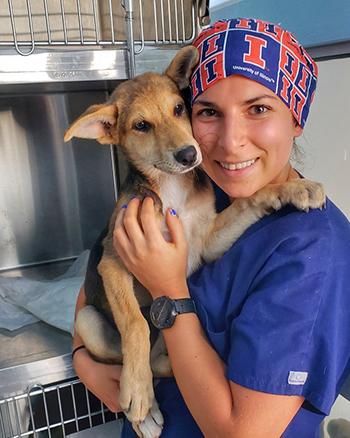 [Anita Kalonaros with dog at shelter in Greece]