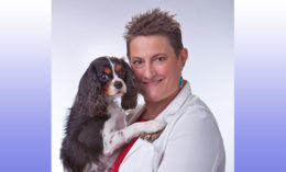 [Dr. Robin Downing and her dog Tommy]