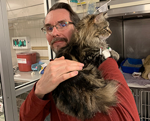 Lucy the cat and her dad, Fred Zwickey.