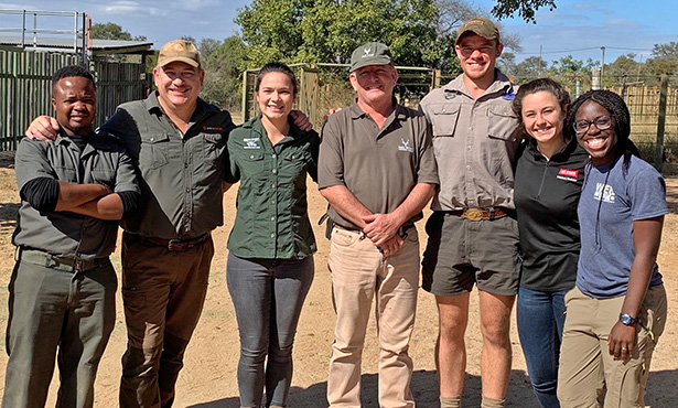 [Taylor Willis, at right, with colleagues at Kruger National Park]